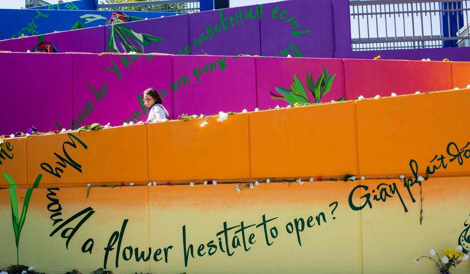 A woman pauses to read the inspirational messages included in the mural at the Hollywood Transit Center Sunday, May 27, 2018.