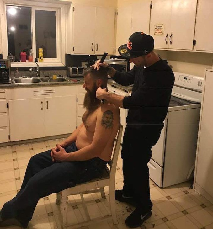 Jacob Lucas cuts a friend's hair at his home in Eugene, while working towards his barber's license.