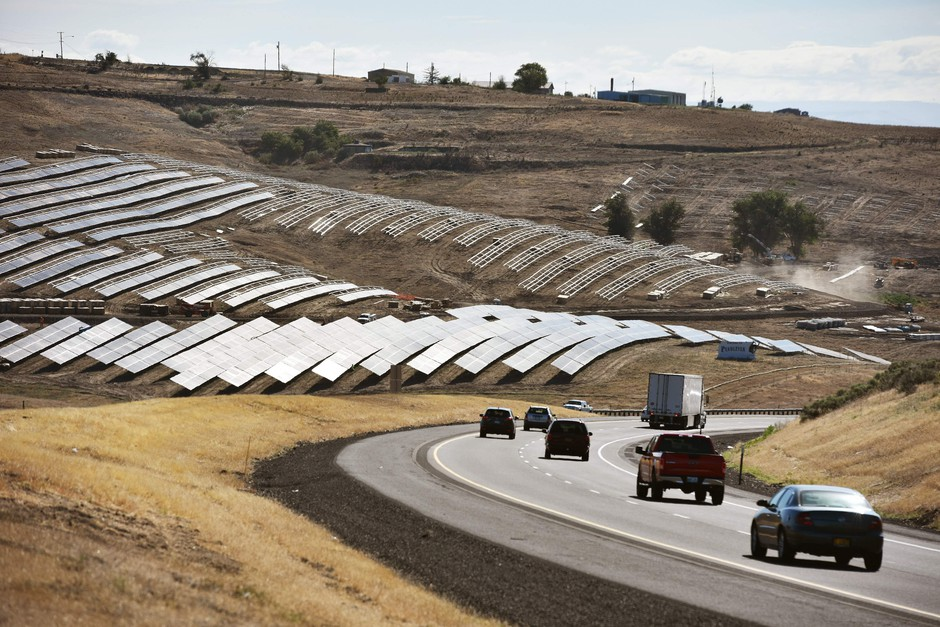 Sunlight reflects off solar panels west of Pendleton, Oregon, along Interstate 84.