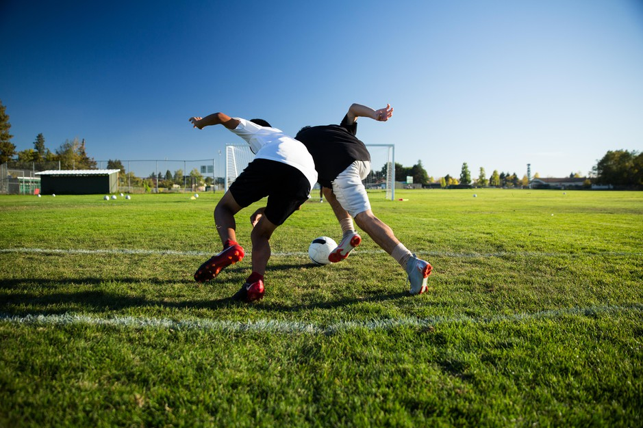 McKay soccer players Ignacio Alarcon (left) and Cesar Gandara compete for a 50-50 ball at practice. Soccer, for many of the players, is an accountability measure.