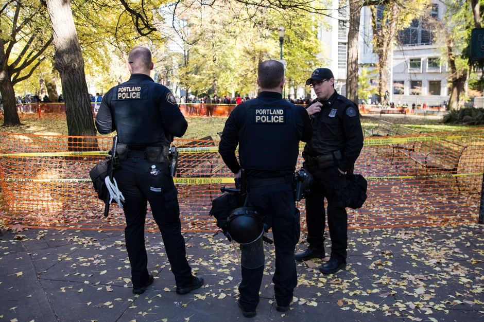 Portland police Lt. Jeff Niiya, right, with the police bureau's rapid response team at a protest in downtown Portland, Ore., Saturday, Nov. 17, 2018.