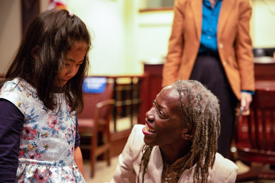 Commissioner Jo Ann Hardesty greets a young supporter on her first day in office at Portland City Hall.