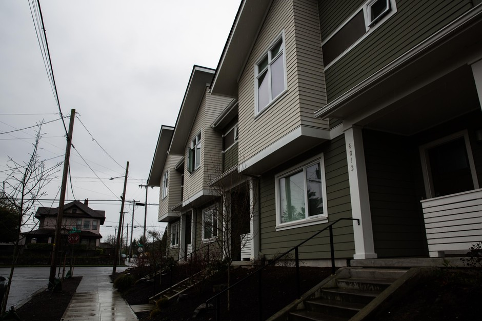 A new triplex is pictured on the corner of Northeast Sixth Avenue and Northeast Ainsworth Street Friday, Feb. 1, 2019, in Portland, Ore. A bill in the state Legislature would change single-family zoning rules to allow more buildings like this in cities looking to grow more dense.