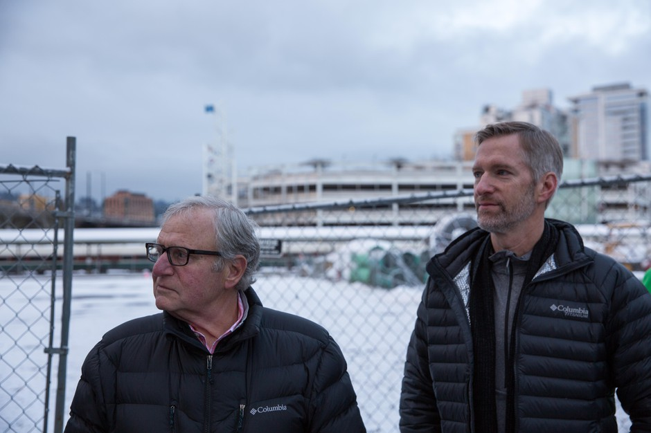 Columbia Sportswear CEO Tim Boyle and Portland Mayor Ted Wheeler attend the groundbreaking ceremony for the new Harbor of Hope homeless center in Portland, Ore., Tuesday, Feb. 5, 2019.