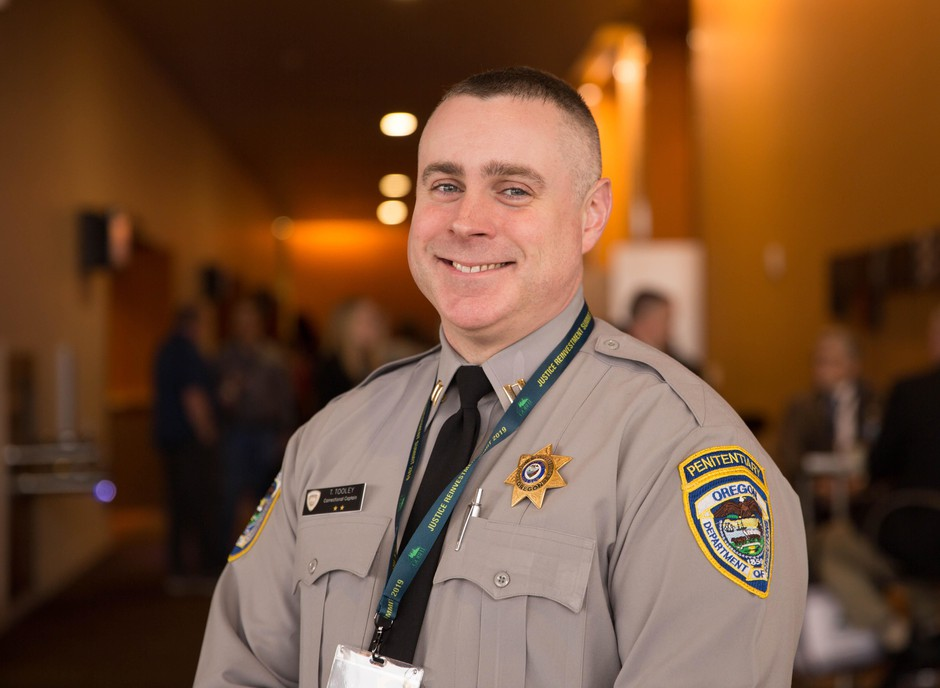 Oregon Corrections Capt. Toby Tooleyposes for a portraitat the Oregon Justice Reinvestment Summit in Salem, Ore., Feb. 14, 2019. Tooley visited Norwegian prisons as part of the Oregon-Norway corrections exchange program.