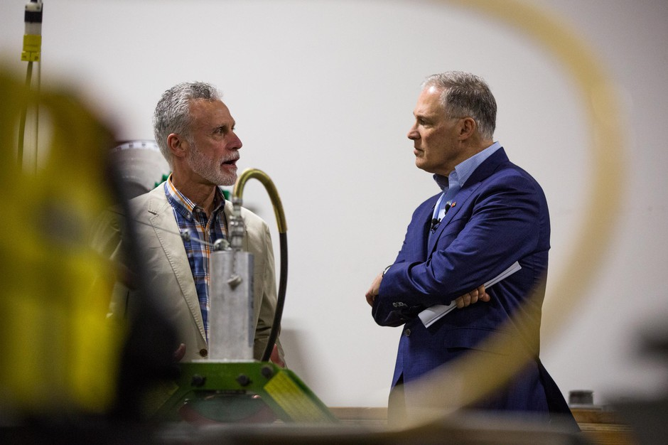 Presidential hopeful and Washington Gov. Jay Inslee, right, speaks with International Brotherhood of Electrical Workers Local 48 business manager Gary Young at the IBEW training center in Portland, Ore., Saturday, March 23, 2019. Inslee is visiting cities across the country as part of the Climate Mission Tour in the early stages of his presidential compaign.