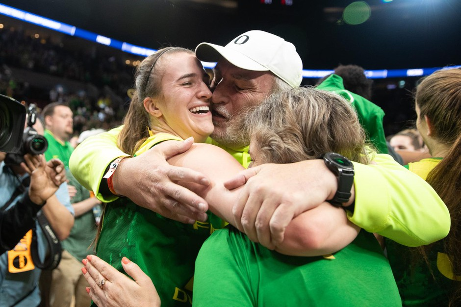 Oregon star Sabrina Ionescu hugs her parents after leading the Ducks to their first women's Elite Eight victory in program history Sunday, March 31, 2019.