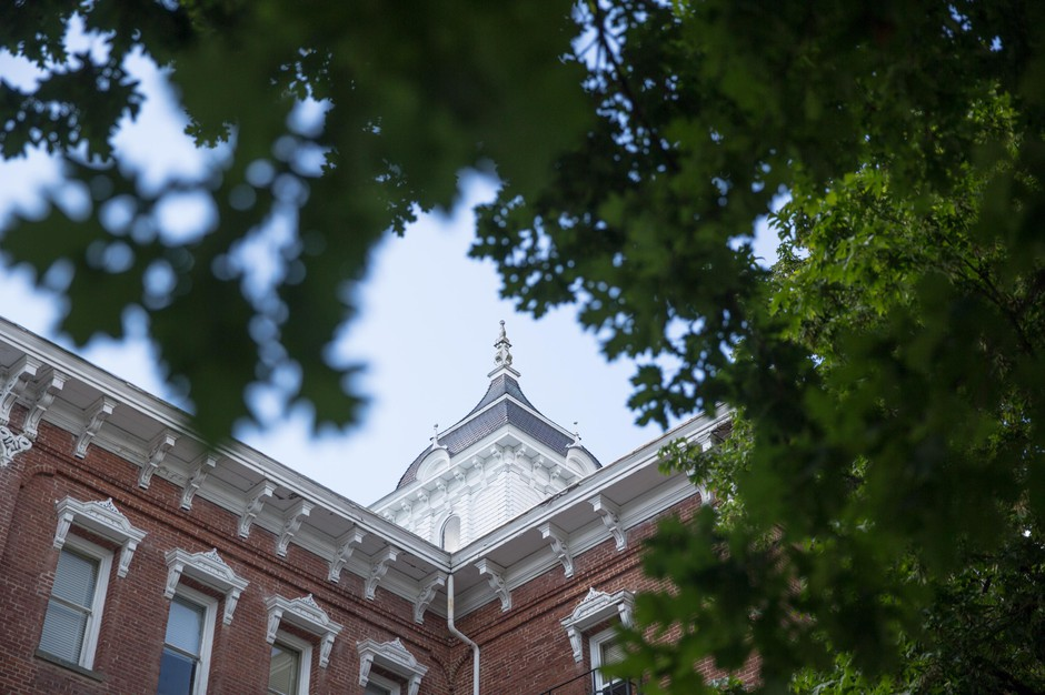 Pioneer Hall is seen through the signature oak trees at Linfield College in McMinnville, Ore., Tuesday, May 21, 2019. Pioneer Hall is the oldest building on the Linfield campus, constructed in 1881.