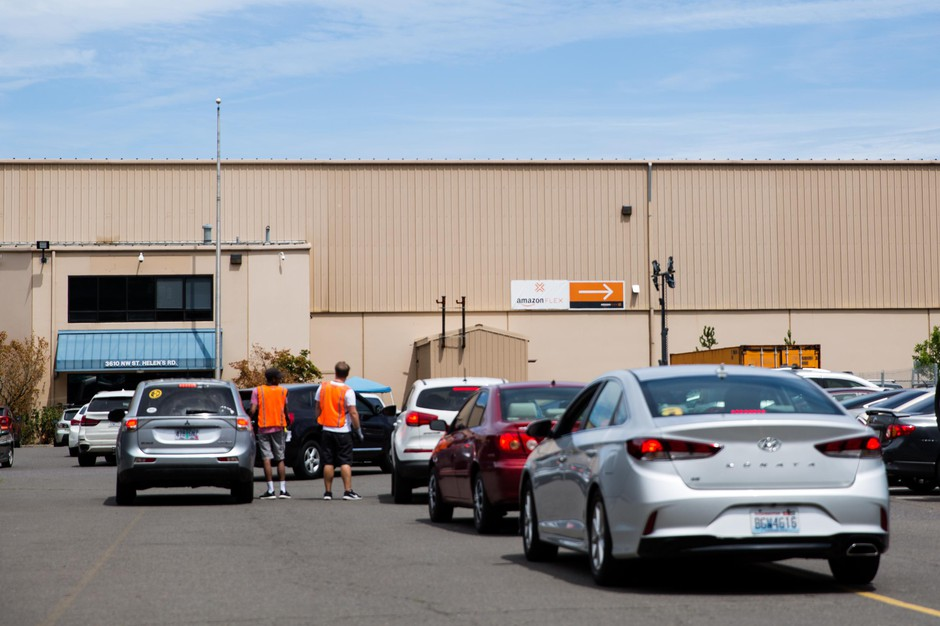 Vehicle queue at Amazon delivery station in northwest Portland, Ore., Friday 12. July 2019.
