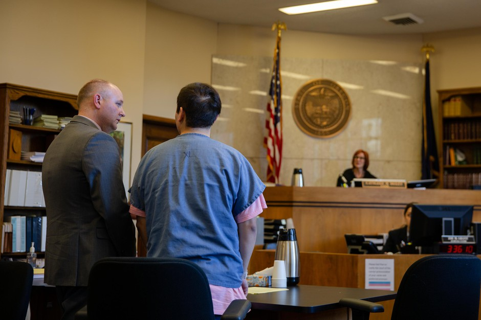 Angel Granados-Diaz, right, speaks to his attorney Adam Thayne during a plea hearing Thursday, Oct. 10, 2019, at the Multnomah County Courthouse in Portland, Ore. Granados-Diaz pleaded guilty to one felony and one misdemeanor after he brought a shotgun to Parkrose High School earlier in the year.