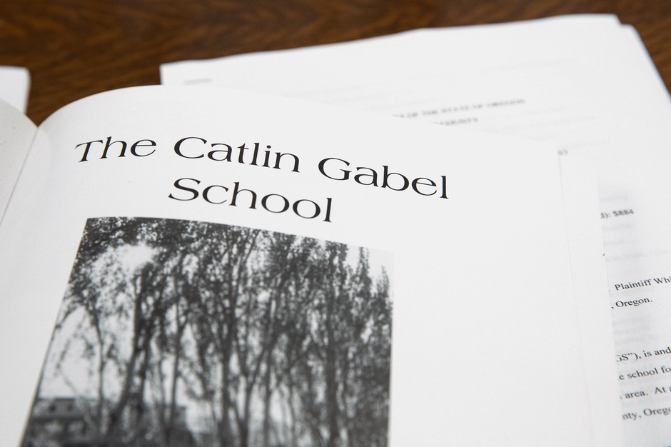 An old yearbook from the Catlin Gabel School is pictured in Portland, Ore., Friday, Feb. 2, 2020. Former students are accusing current and former Catlin Gabel staffers of sexual abuse, providing illegal drugs to minors, and more.