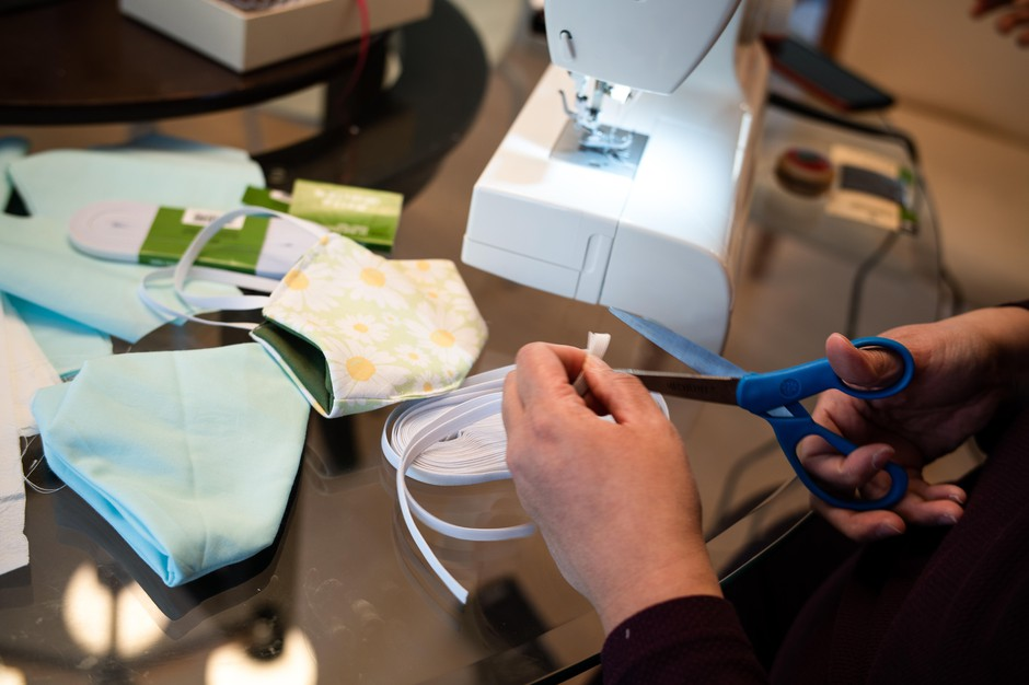Aurora Oliva Ma of Beaverton, Ore., sews DIY protective face masks using materials purchased from JoAnn Fabrics at her home on March 19, 2020. Oregon Health & Science University officials say, for now, they are researching effective materials and sewing patterns people could use to sew masks for them.