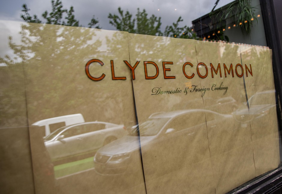 Parked cars reflect on the paper-covered windows of the Clyde Common restaurant in Portland, Ore., on Tuesday, May 12, 2020. Owner Nate Tilden shuttered it when the coronavirus outbreak reached Oregon. He says the restaurant will not come back as it was pre-pandemic and plans to remodel the space to allow for the creation of a market and a smaller tavern-style restaurant.