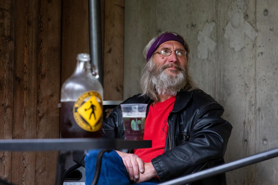 Don Impson enjoys a beer at Walking Man Brewing Company in Stevenson, Wash., Thursday, May 14, 2020. Walking Man opened its beer garden to customers as Skamania County entered the first phase of reopening amid the COVID-19 pandemic.