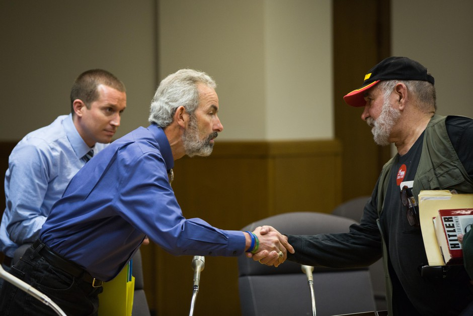 State Sen. Floyd Prozanski, D-South Lane and North Douglas counties, greets a member of the public at the conclusion of the Oregon Senate Judiciary Committee's hearing on Senate Bill 978 the Oregon Capitol in Salem, Ore., Tuesday, April 2, 2019. An opponent of the gun control bill shares his thoughts with the head of the committee after it adjourns.