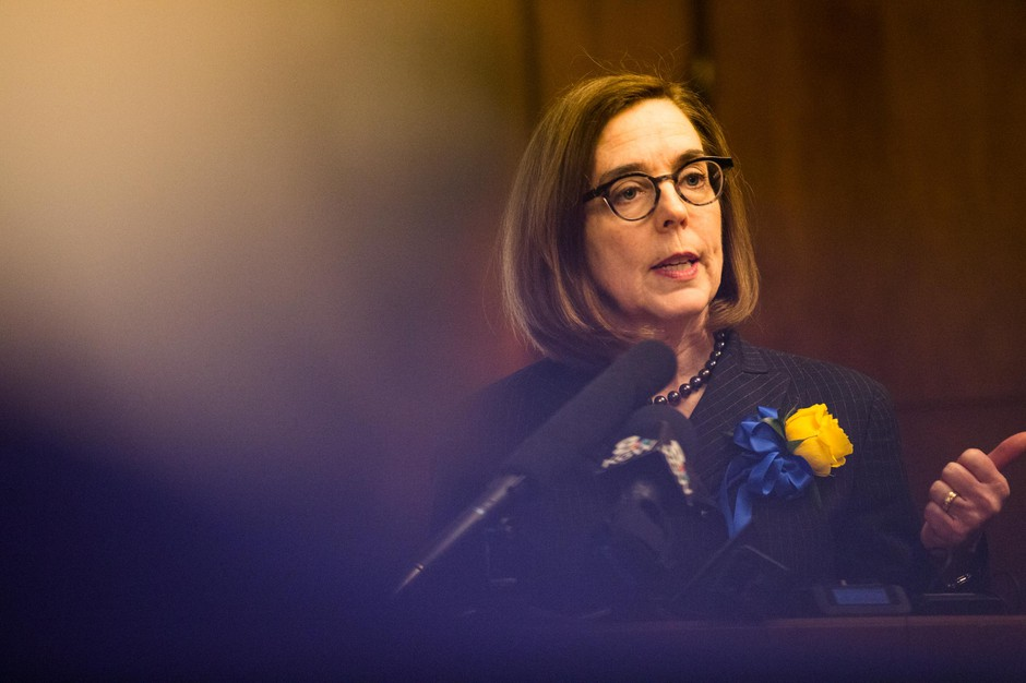 Oregon Gov. Kate Brown speaks to reporters in her ceremonial office at the Capitol in Salem, Ore., Monday, Jan. 14, 2019.
