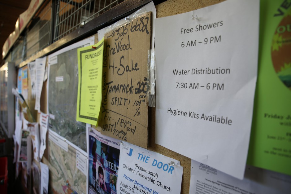 A sign at the Warm Springs Market directs people on the reservation to emergency water supplies, June 29, 2019.