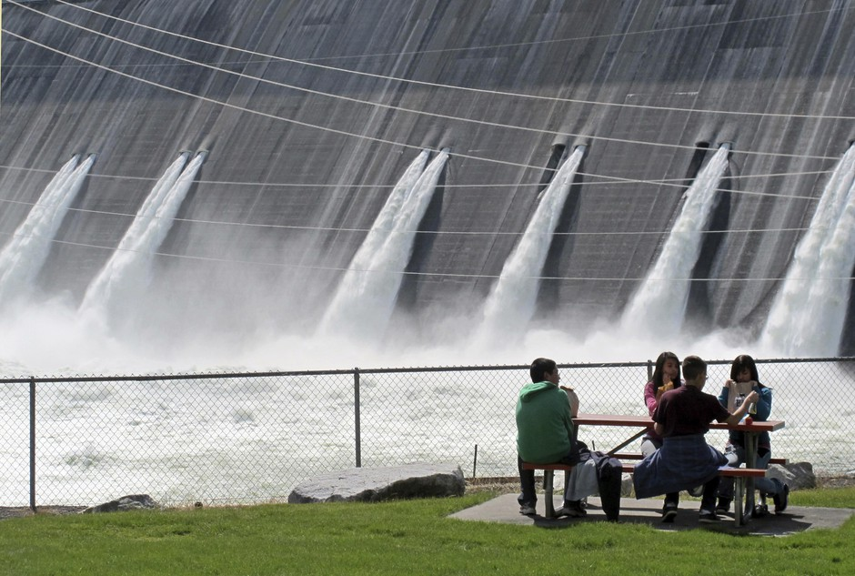 In this June 1, 2011 file photo, water is released through the outlet tubes at Grand Coulee Dam, Wash., on the Columbia River.