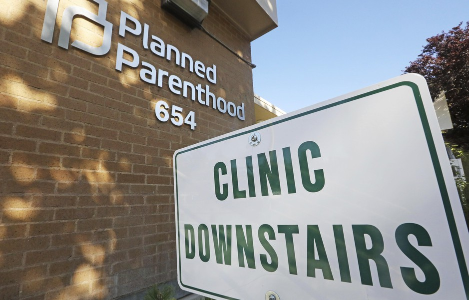 A sign is displayed at Planned Parenthood of Utah Wednesday, Aug. 21, 2019, in Salt Lake City. About 39,000 people received treatment from Planned Parenthood of Utah in 2018 under a federal family planning program called Title X. The organization pulled out of the program rather than abide by a new Trump administration rule prohibiting clinics from referring women for abortions.