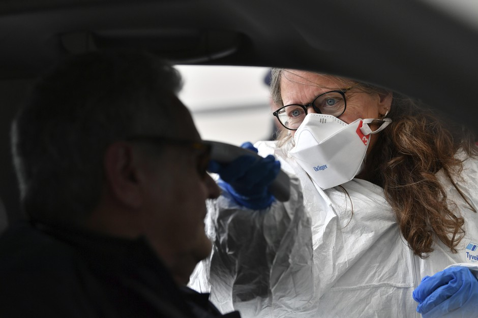 A member of the medical staff measures the temperature of a traveller at a autobahn park place near Gries am Brenner, Austrian province of Tyrol, at border crossing with Italy on Tuesday, March 10, 2020. Austria authorities started on random checks of arriving vehicles at the border crossings with Italy in reaction to the outbreak of the new coronavirus in Europe, particularly in Italy. As part of the move, officials measure the temperatures of some passengers in cars, trucks and buses. For most people, the new coronavirus causes only mild or moderate symptoms, such as fever and cough. For some, especially older adults and people with existing health problems, it can cause more severe illness, including pneumonia.
