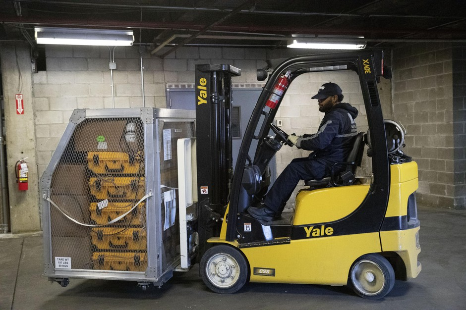 A cage of ventilators is moved by forklift, Tuesday, March 24, 2020 at the New York City Emergency Management Warehouse, where 400 ventilators have arrived and will be distributed.