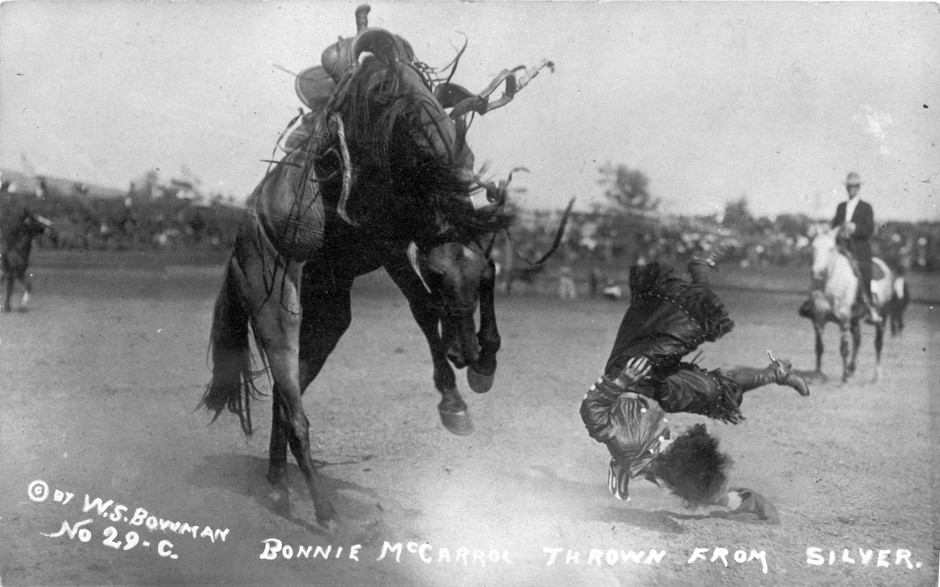 Cowgirl Bonnie McCarroll is thrown from a horse named Silver during a bucking contest at Pendleton Round-Up. After the Round-Up started in 1910, cowgirls were stars until McCarroll was killed in a bronc-riding accident in 1929.