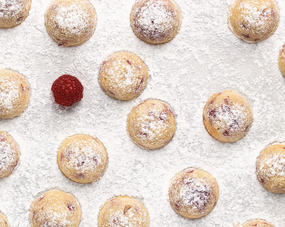 """These Raspberry Almond Tea Cakes from """"Modern French Pastry""""are """"easy"""" (earning only one-half macaron out of three) and can be filled with frozen berries out of season."""