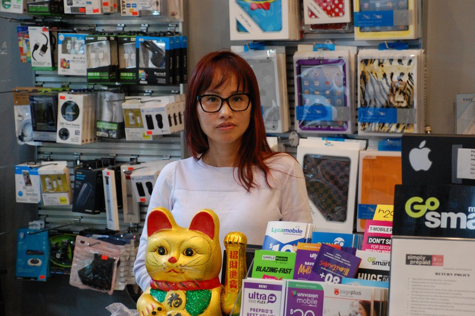 Heidi Huynh stands in her shop in Portland's Jade District on May 12, 2020. She's been helping some Vietnamese speaking customers navigate their unemployment applications in English.