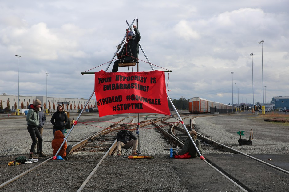 Environmental activists from Portland Rising Tide built a tripod in the middle of a rail line to block access to Terminal 5 at the Port of Vancouver on Thursday, Oct. 17, 2019. Activists attempted to block trains carrying materials for the Trans Mountain Pipeline Expansion Project in Canada.