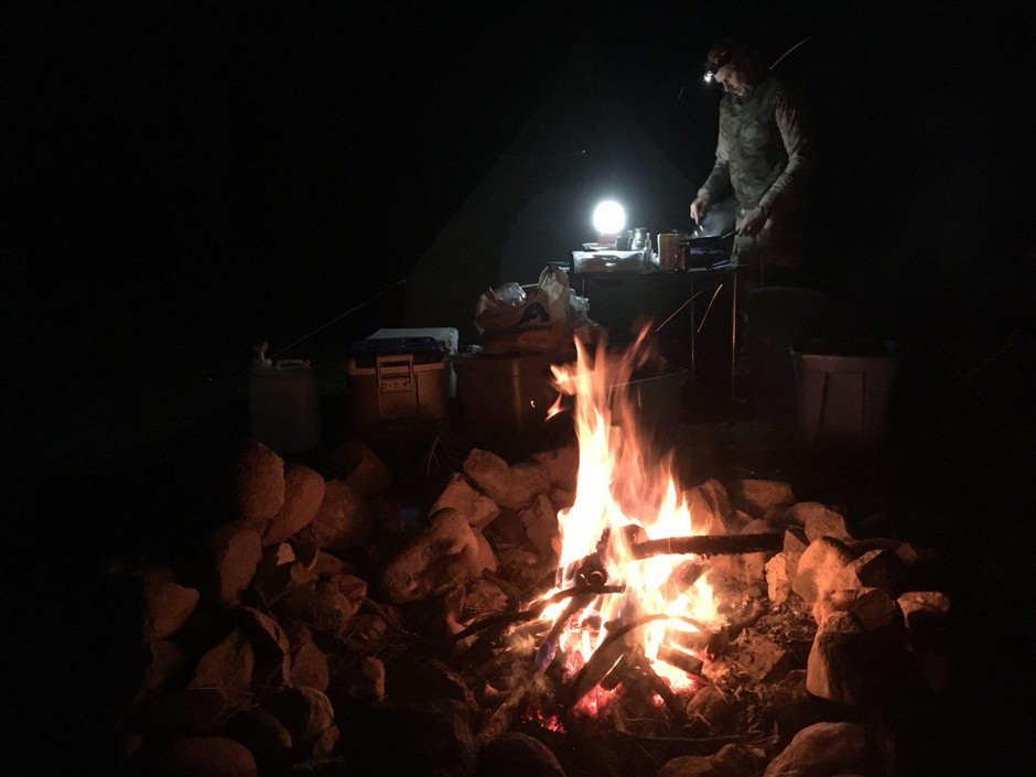 Roger Phillips prepares dinner at camp during a deer and elk hunt in central Idaho. Hunting has been declining in America, meaning less money for state conservation efforts.