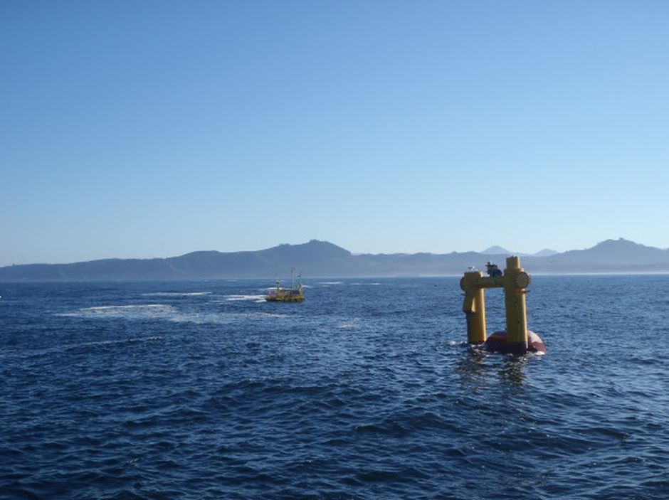 The OSU Ocean Sentinel test facility buoy (left) and the WET-NZ wave energy conversion device (right) during acoustic recording and monitoring sound levels at the site during device testing.
