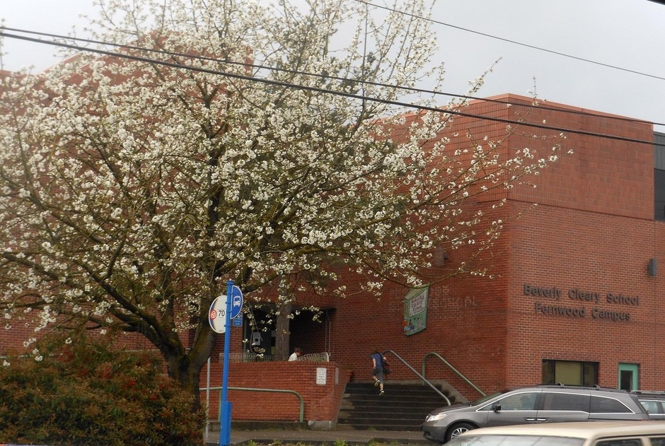 A student enters Beverly Cleary school in Portland, Ore., April 4, 2013.