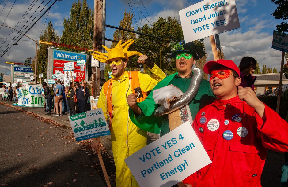 Supporters of Measure 26-201 rally outside of Walmart and U.S. Bank branches in East Portland on Oct. 9, 2018.