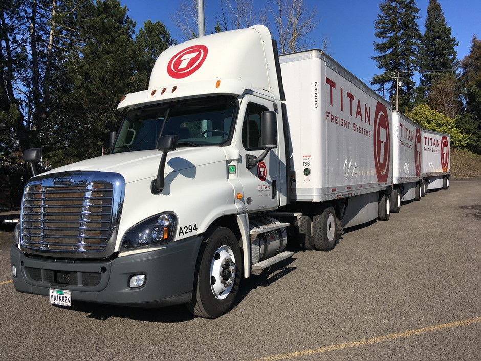 A Titan Freight truck with 10 fuel-efficiency features added on gets better gas mileage than some trucks, but still gets less than 7.5 miles per gallon.