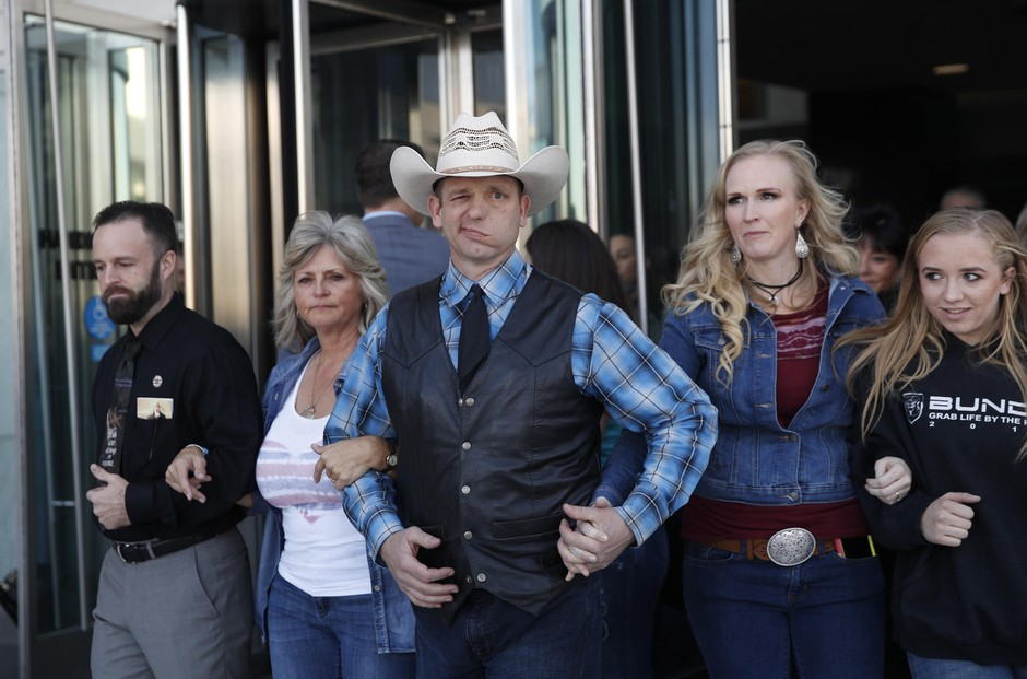 "From left, Ryan Payne, Jeanette Finicum, widow of Robert ""LaVoy"" Finicum, Ryan Bundy, Angela Bundy, wife of Ryan Bundy and Jamie Bundy, daughter of Ryan Bundy, walk out of a federal courthouse, Dec. 20, 2017, in Las Vegas, Nevada."
