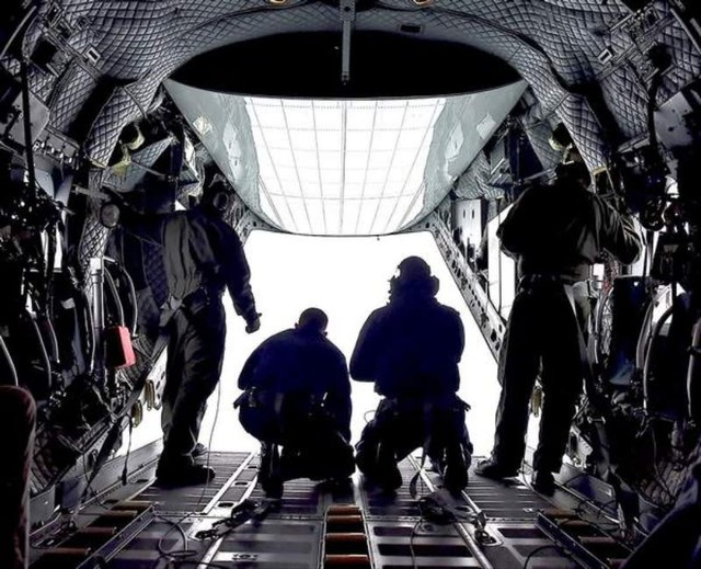 A Coast Guard crew monitors the crab fleet at the mouth of the Columbia River from a C-27 aircraft.