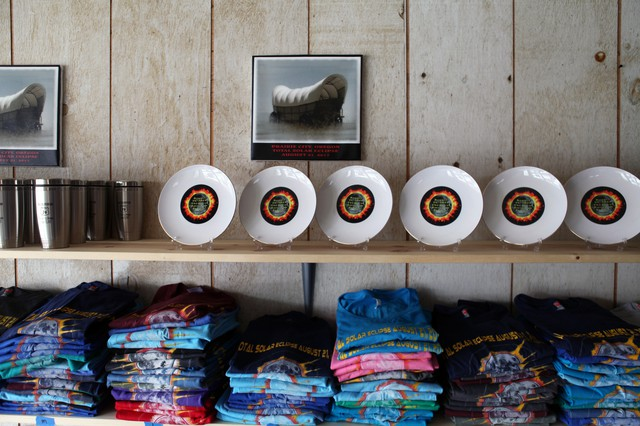 """A number of small-town entrepreneurs have already started producing eclipse-themed souvenirs, like the pop-up shop Grumpy's Eclipse Central in Prairie City, whose tagline is """"Fine art and not so fine art."""""""