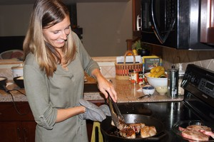 Tess Vining cooks locally-raised lamb as part of the High Desert Food and Farm Alliance's local food challenge.
